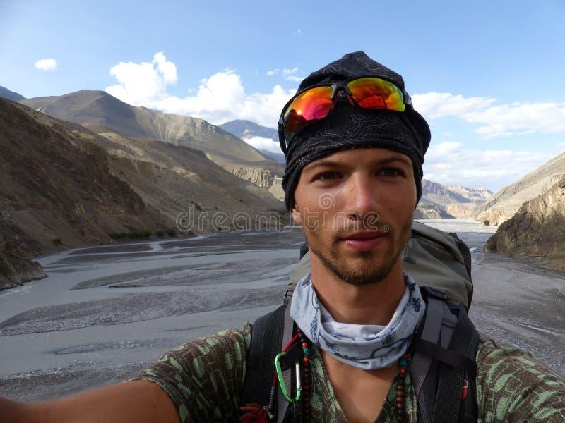 Tourist take selfie - Valley of wild river Kali Gandaki royalty free stock image