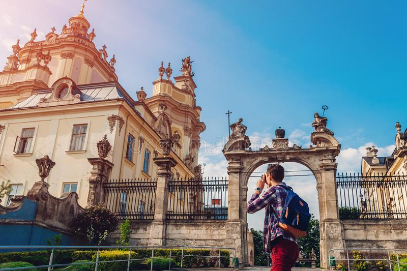 Tourist takes pictures of catholic cathedral of st. George in Lviv, Ukraine. royalty free stock image