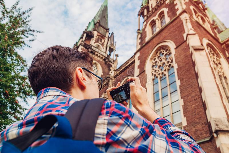 Tourist takes pictures of catholic church of St. Olha and Elizabeth in Lviv, Ukraine. stock photography