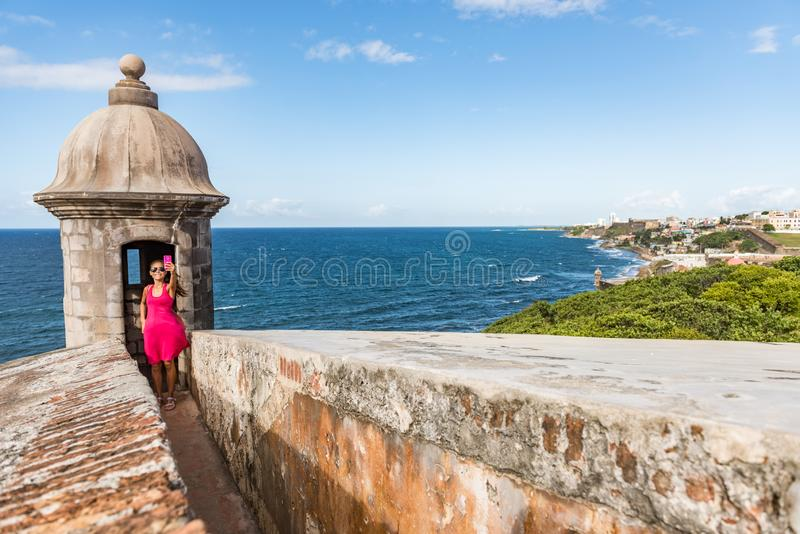 Puerto Rico San Juan city travel tourist taking phone selfie photo at Castillo San Felipe Del Morro fortress. Tourism in Old San royalty free stock photos