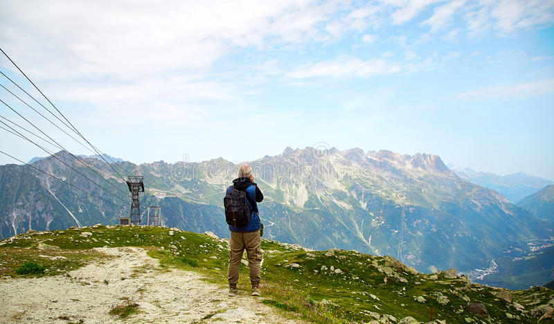 Tourist taking a landscape of French Alps. Chamonix, France - JULY 19, 2017: Traveler tourist taking a landscape of French Alps, Chamonix Mont Blanc royalty free stock image