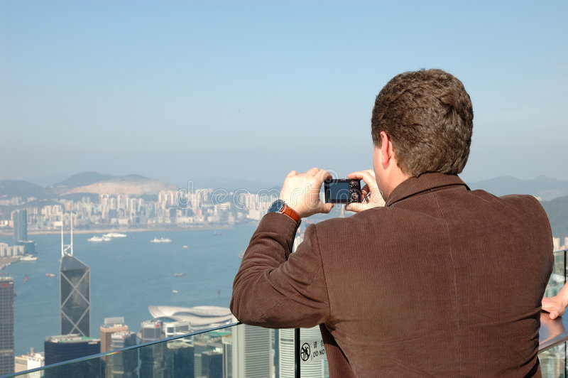 Tourist taking photo royalty free stock images