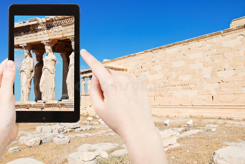 Tourist taking photo of caryatids at acropolis. Travel concept - tourist taking photo of caryatids at acropolis on mobile gadget, Athens, Greece stock photography