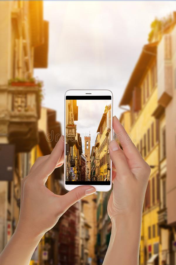 Tourist makes a photo of view of Florence street royalty free stock photography