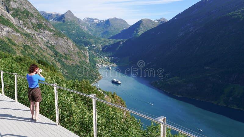 Tourist taking photo of fjord landscape, Norway stock photos