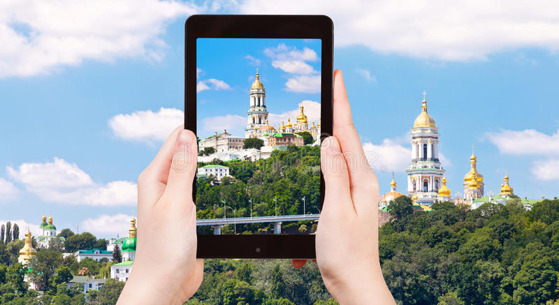 Tourist taking photo of Kiev Pechersk Lavra stock photography