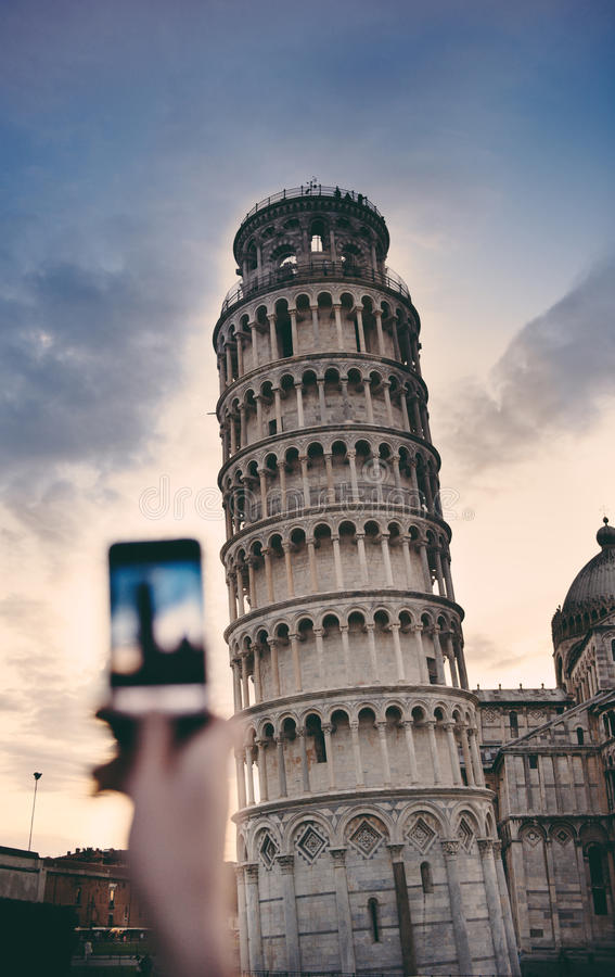 Tourist taking a photo at the Pisa Tower stock photography