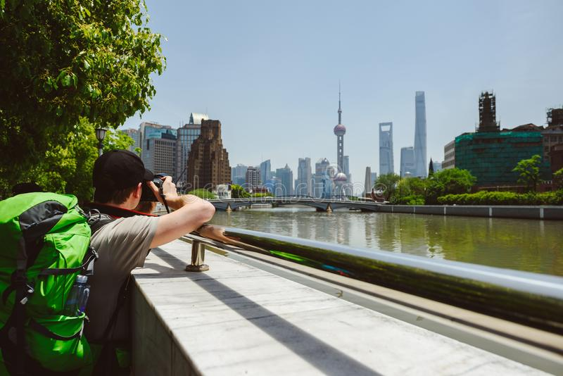 Tourist taking photo of Pudong new area, Shanghai. SHANGHAI, CHINA - MAY 04, 2016: Tourist taking photo of Pudong new area, Shanghai, China stock photos