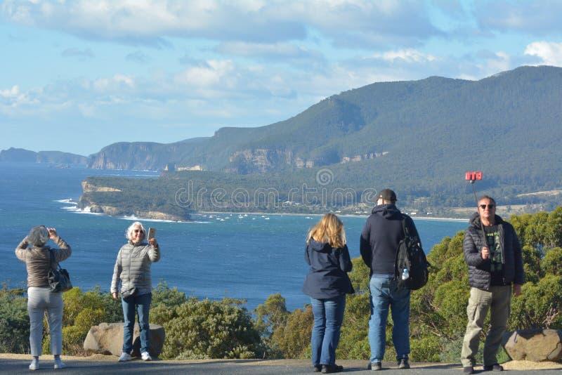 Tourist taking photos ands selfie in Tasmania Australia royalty free stock photos