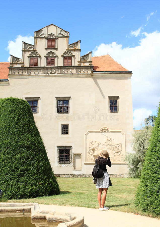 Tourist taking photos of palace of Castle in Telc royalty free stock photos