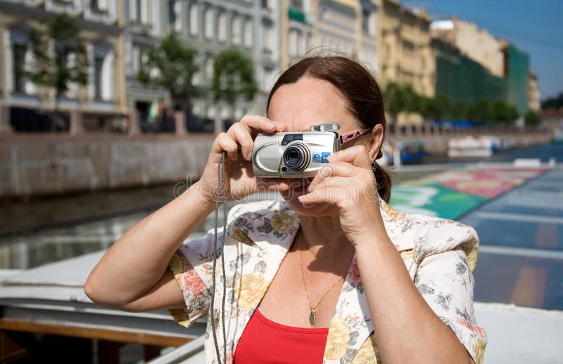 Tourist taking pictures. During the boat trip royalty free stock photography