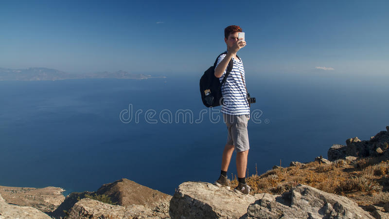 Tourist taking pictures with a mobile phone stock image