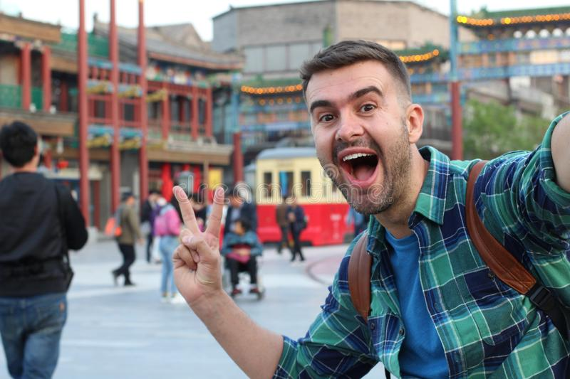 Tourist taking selfie in Asia showing peace sign.  stock images