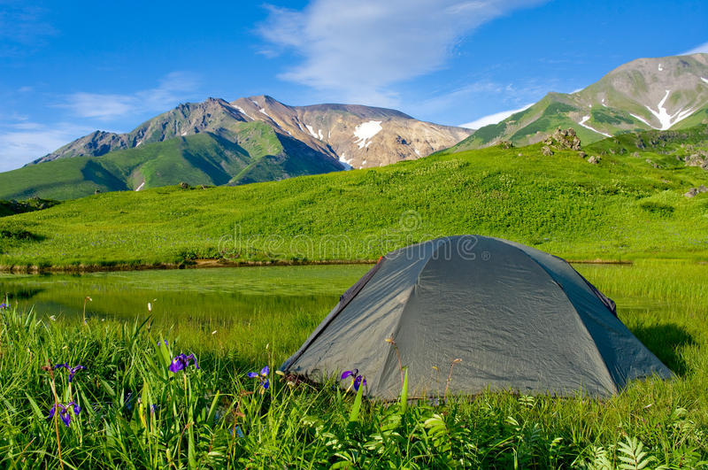 Tourist tent in the in mountains royalty free stock image