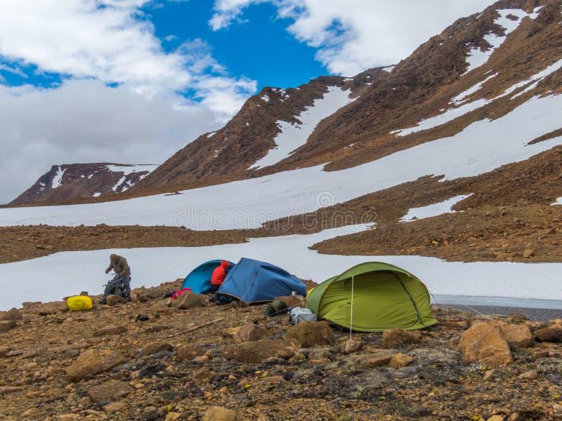 Tourist tents in the mountains. Beautiful mountain. Landscape, panorama. Snowy peak. Polar urals mountains. Yamal stock image