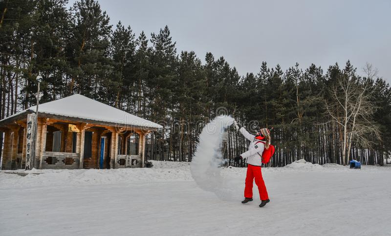 A tourist throwing hot water  at winter park stock images