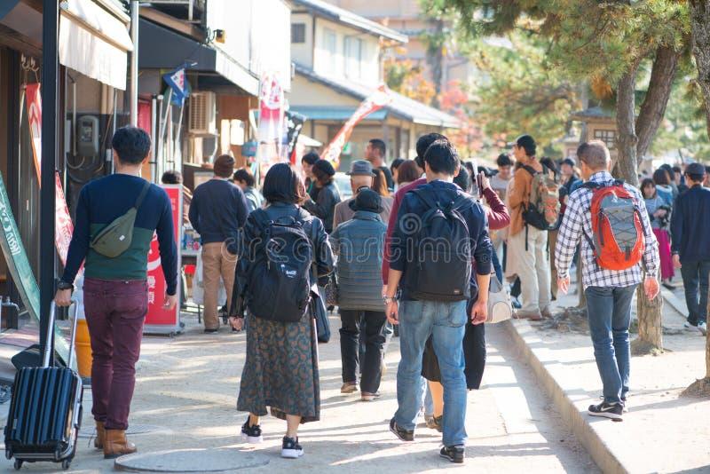 Tourist to see Floating torii gate of Itsukushima Shrine in autumn season at Miyajima island. Hiroshima, Japan stock photos