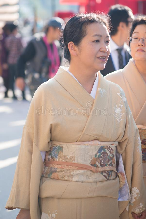 Tourist to see Floating torii gate of Itsukushima Shrine in autumn season at Miyajima island. Hiroshima, Japan royalty free stock images