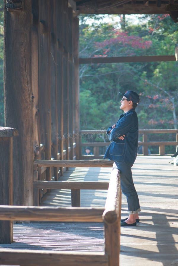 Tourist to see Floating torii gate of Itsukushima Shrine in autumn season at Miyajima island. Hiroshima, Japan stock images