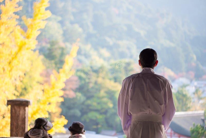 Tourist to see Floating torii gate of Itsukushima Shrine in autumn season at Miyajima island. Hiroshima, Japan royalty free stock photos