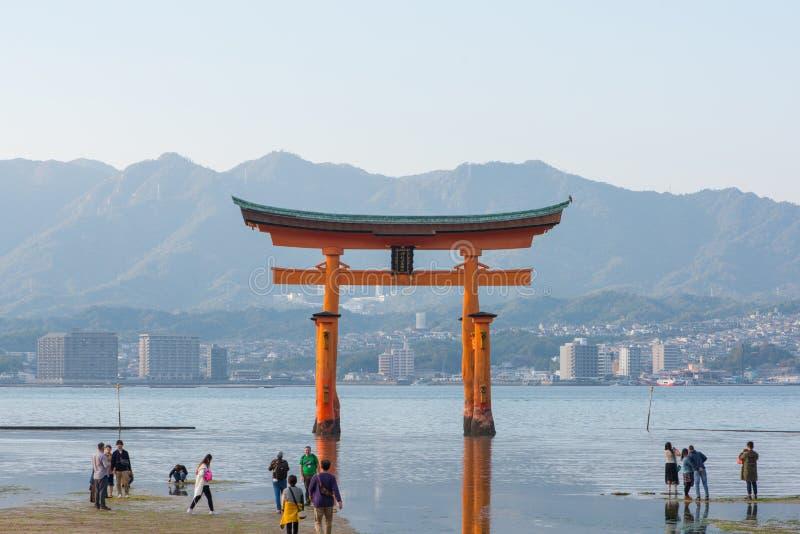 Tourist to see Floating torii gate and pray of Itsukushima Shrine at Miyajima island. Hiroshima, Japan stock images