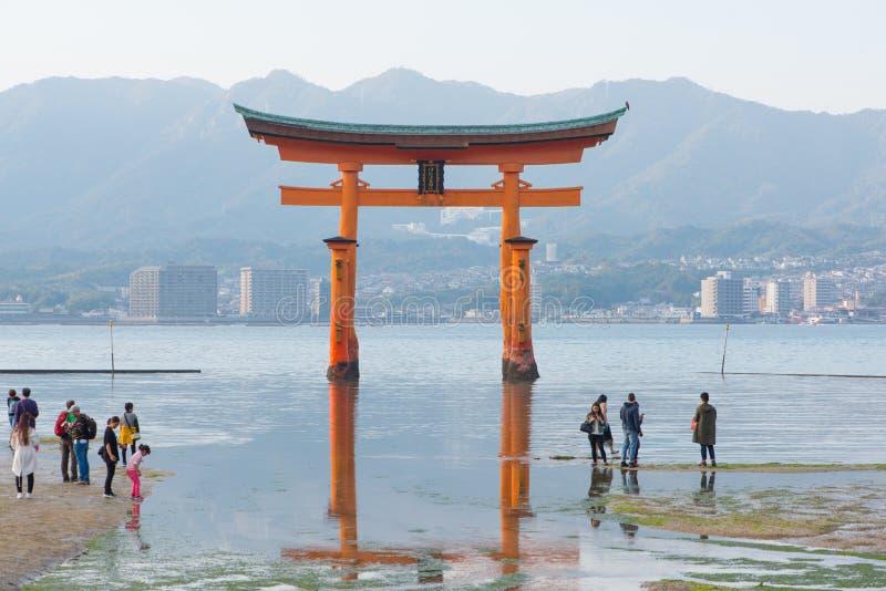 Tourist to see Floating torii gate and pray of Itsukushima Shrine at Miyajima island. Hiroshima, Japan royalty free stock photography