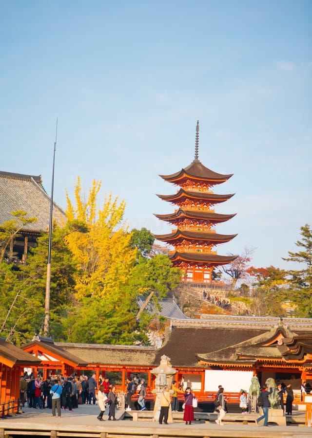 Tourist to see Floating torii gate and pray of Itsukushima Shrine at Miyajima island. Hiroshima, Japan royalty free stock images