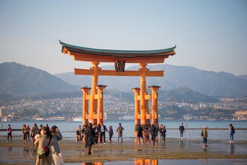 Tourist to see Floating torii gate and pray of Itsukushima Shrine at Miyajima island. Hiroshima, Japan stock photos