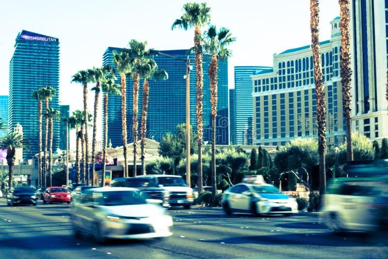 Tourist traffik on the Las Vegas Boulevard. Expensive cars and luxury hotels. Las Vegas, Nevada, USA - June 18, 2017: Fast car traffic on the boulevard of Las royalty free stock image