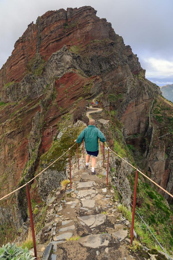 Tourist on the trail on the edge in Madeira stock images