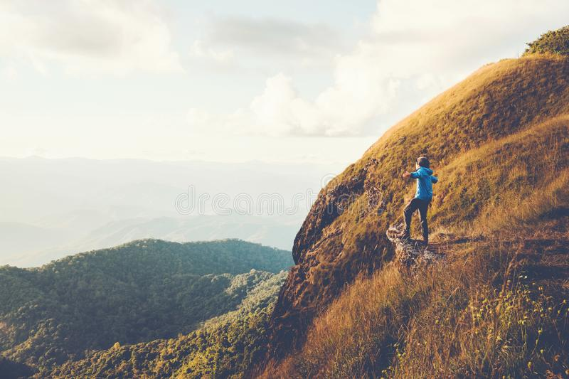 Tourist trail hiking in the forest Traveler Man Relax and crossing the mountain Traveler concept royalty free stock photos