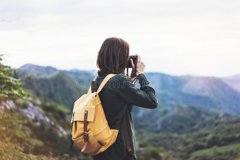 Tourist traveler photographer taking pictures of amazing landscape on vintage photo camera on background valley view mockup sun stock photos
