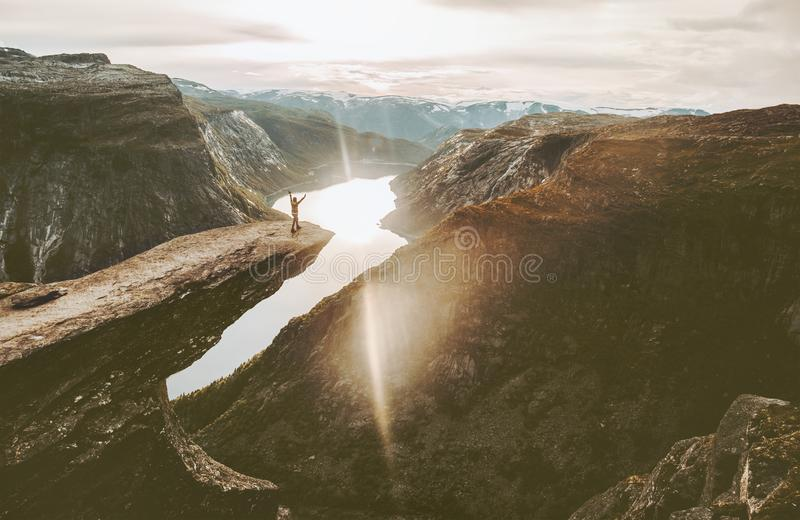 Tourist on Trolltunga cliff edge in Norway adventure travel. Lifestyle active vacations outdoor sunset mountains landscape stock photos