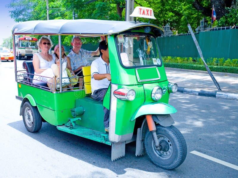 Tourist on '' tuk tuks '' in Bangkok royalty free stock image