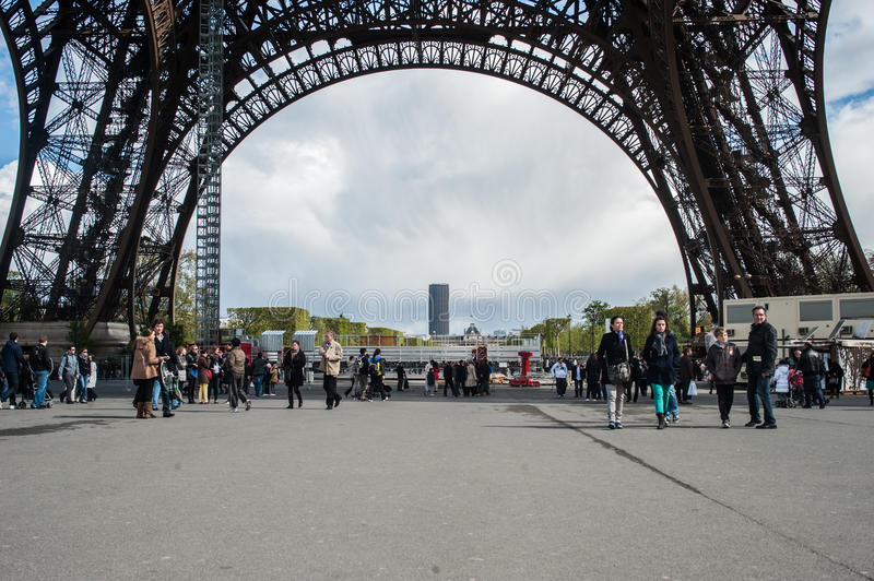 Tourist under the Eiffel Tower royalty free stock image