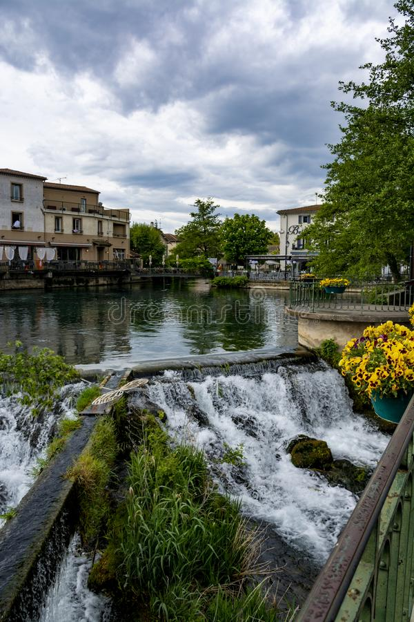 Tourist and vacation destination, small Provencal town lIsle-sur-la-Sorgue with green water of Sotgue river. Tourist and vacation destination, view on small stock photo