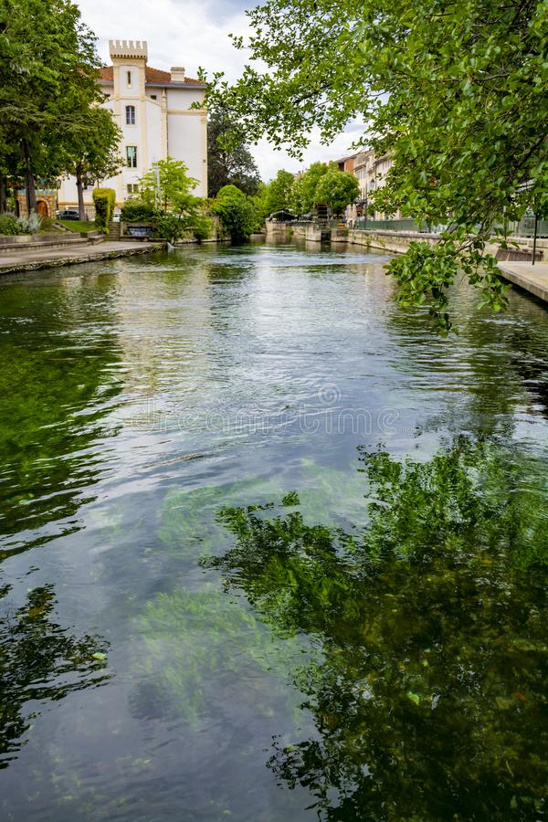 Tourist and vacation destination, small Provencal town lIsle-sur-la-Sorgue with green water of Sotgue river. Tourist and vacation destination, view on small stock photography