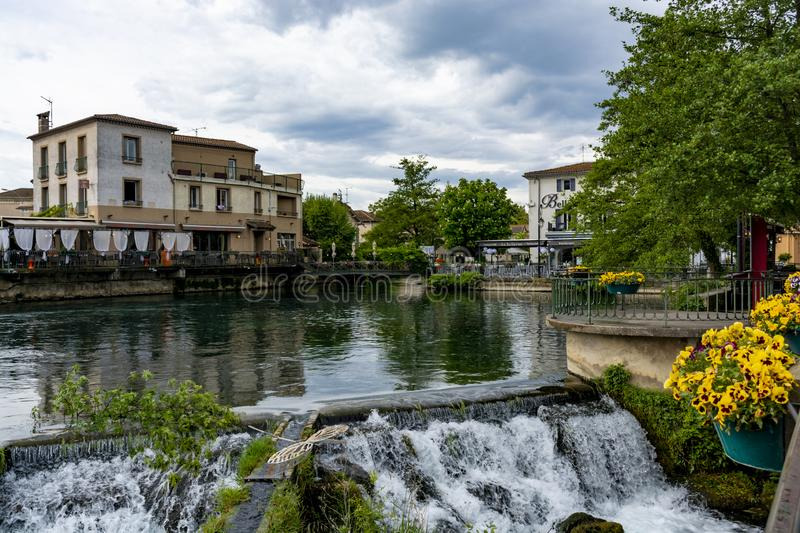 Tourist and vacation destination, small Provencal town lIsle-sur-la-Sorgue with green water of Sotgue river. Tourist and vacation destination, view on small royalty free stock photos