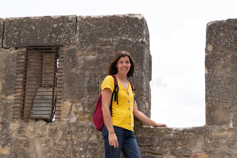 Tourist vacation woman walking in the Carcassonne ancient medieval tower city stock images
