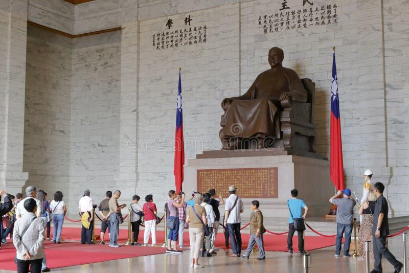 Tourist visit jiangjieshi statue. Chiang kai - shek seated figure in jiang jieshi memorial hall in taipei city stock photo