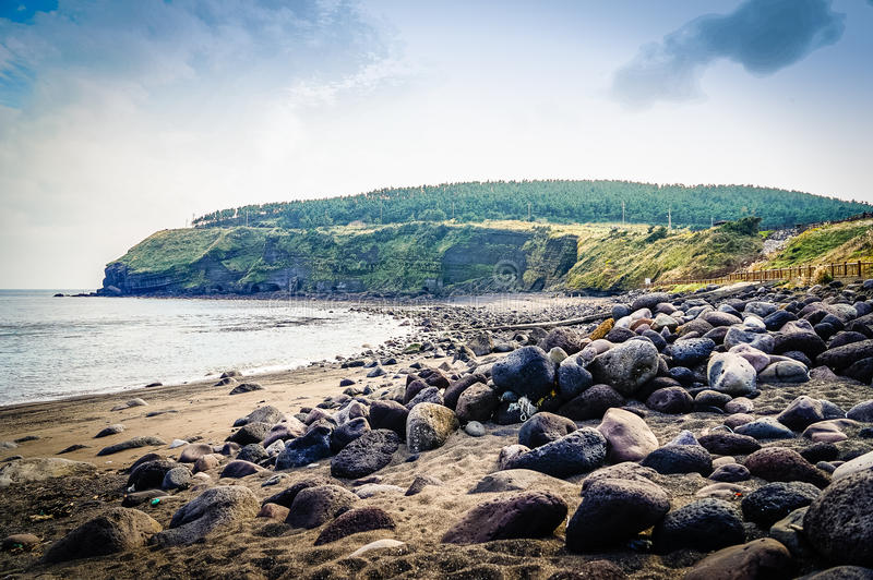The tourist visited Seongaksan coast, the famous coastal drive w. Ith breathtaking scenic views in Jeju island stock images
