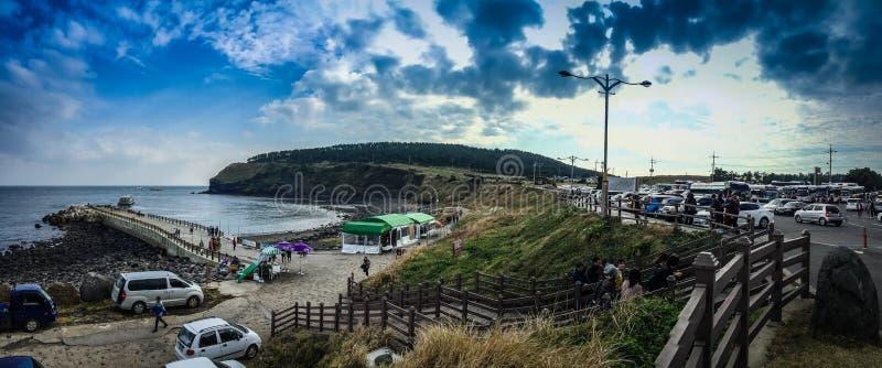 The tourist visited Seongaksan coast, the famous coastal drive w. Ith breathtaking scenic views in Jeju island royalty free stock photo