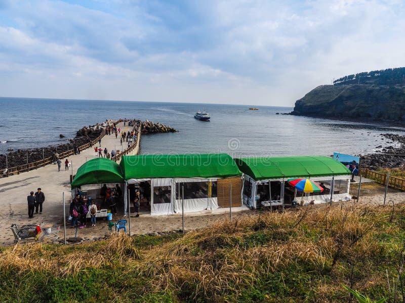 The tourist visited Seongaksan coast, the famous coastal drive w. Ith breathtaking scenic views in Jeju island royalty free stock photos