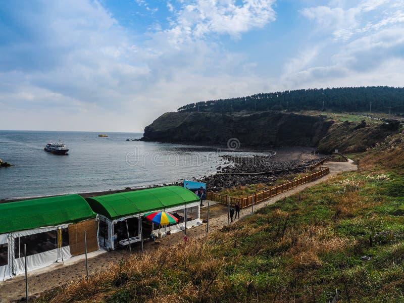 The tourist visited Seongaksan coast, the famous coastal drive w. Ith breathtaking scenic views in Jeju island stock image