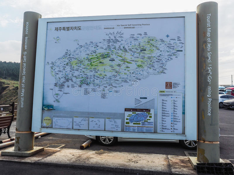 The tourist visited Seongaksan coast. Jeju Island, KOREA - NOVEMBER 12: The tourist visited Seongaksan coast, the famous coastal drive with breathtaking scenic stock photo