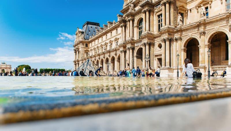 Tourist visiting Louvre, Paris sightseeing royalty free stock photos