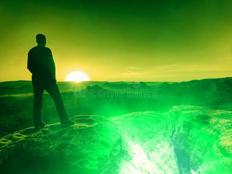 Tourist walker in landscape with blue sky sunset over horizon stock photo