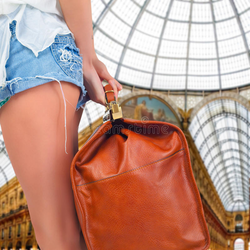 Tourist woman adventure with luggage in Milan stock photo