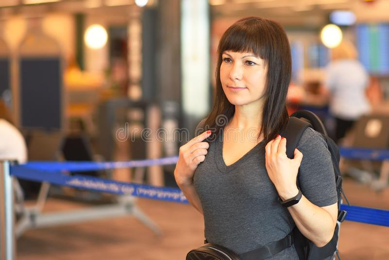 Tourist woman at the airport. stock image