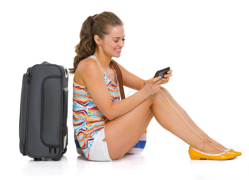 Download Tourist Woman With Bag Sitting On Floor And Writing Sms Stock Image - Image of excursion, background: 30645477